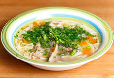 Chicken soup with noodles and vegetables in ceramic bowl Royalty Free Stock Images