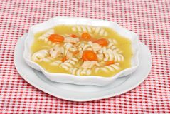 Chicken soup with pasta Stock Images