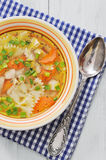 Chicken soup with pasta Stock Photos
