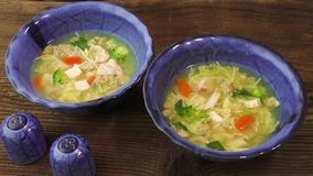 Chicken soup with pasta and vegetables stock video