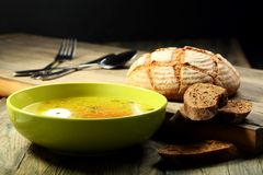 Chicken soup with poached egg . Stock Images