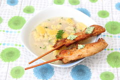 Chicken soup. A chicken soup with some skewers Stock Photography