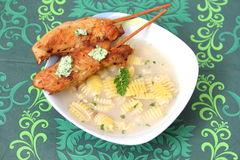 Chicken soup. A chicken soup with some skewers stock images