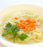 Chicken soup with spaghetti royalty free stock photo
