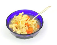 Chicken soup and spoon Stock Photos