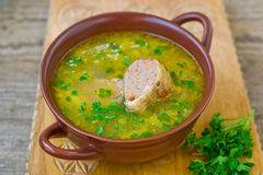Chicken soup with the stuffed chicken neck Stock Images