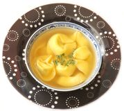Chicken soup with tortellini Stock Image