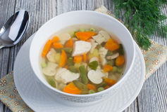 Chicken soup with vegetables and mushrooms Stock Photos