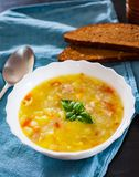 Chicken soup with vegetables and rice in white Bowl. On wooden table Stock Photo