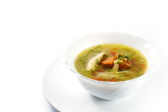 Chicken soup with vegetables in a white bowl, isolated Royalty Free Stock Image
