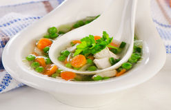 Chicken soup with vegetables in  white bowl. Royalty Free Stock Photography