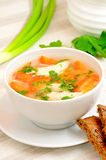 Chicken soup with vegetables in white bowl Stock Photo