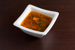 Chicken Soup on wooden table Stock Image