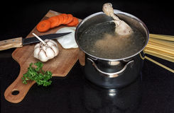 Chicken soupwith fresh vegetables, noodles and beans Stock Photo