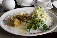Chicken in sour cream sauce with rice. And cabbage salad Stock Photo
