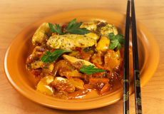 Chicken with sourish-sweet sauce. Chinese chicken with sourish-sweet sauce and chopsticks Stock Images