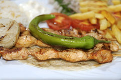 Chicken souvlaki. Served with french fries Stock Image