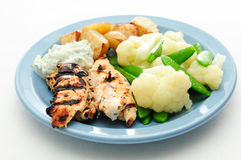 Chicken souvlaki grilled with roast potatoes Stock Images