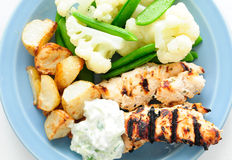 Chicken souvlaki grilled with roast potatoes Stock Photography