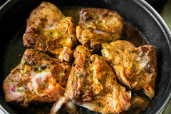 Chicken on frying pan Stock Photos
