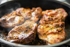 Chicken on frying pan Royalty Free Stock Photos