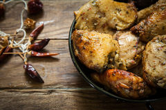 Chicken with spices stock photography