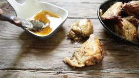 Chicken with spices stock video