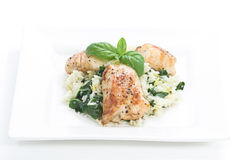 Chicken & Spinach dish # 2. Chicken and rice with spinach and lemon toped with basil leaves Stock Image