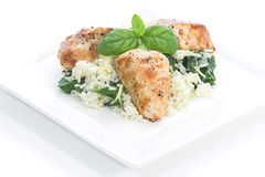 Chicken & Spinach dish # 3. Chicken and rice with spinach and lemon toped with basil leaves Royalty Free Stock Photo