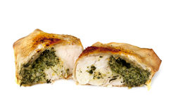Chicken and Spinach Filo Parcel over White. Chicken and spinach filo parcel cut in half, isolated on white background Stock Image