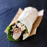 Chicken spinach mushroom wrap on slate Royalty Free Stock Photography