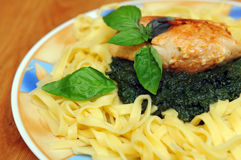Chicken with spinach and pasta Royalty Free Stock Photo