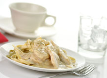 Chicken with spinach pasta Stock Photography
