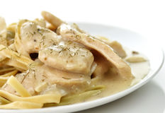 Chicken with spinach pasta Stock Images
