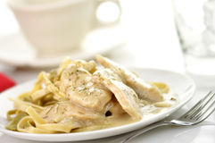 Chicken with spinach pasta Royalty Free Stock Photos