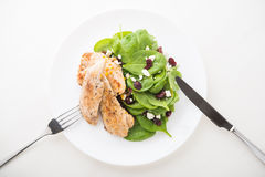 Chicken with spinach salad Royalty Free Stock Image