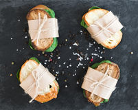 Chicken and spinach sandwiches wrapped in craft paper Royalty Free Stock Photography