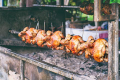 Chicken on the spit Stock Images