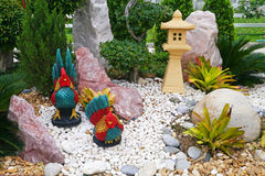 Chicken statues in the garden Stock Images