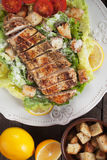 Chicken steah with caesar salad Stock Photography