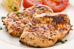 Chicken Steak. Spicy chicken steak with vegetables as closeup on a plate Royalty Free Stock Photo