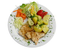 Chicken steak. With boiled potatoes and vegetables on white plate Stock Photo