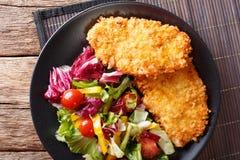 Chicken steak in breadcrumbs Panko and fresh vegetable salad clo Stock Photo