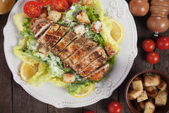 Chicken steak with caesar salad Royalty Free Stock Photography