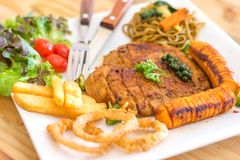 Chicken Steak. Serve with sausage,onion ring,french fried, salad and spaghetti basil sauce Royalty Free Stock Photo