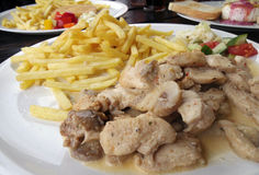 Chicken steak with french fries Stock Photography
