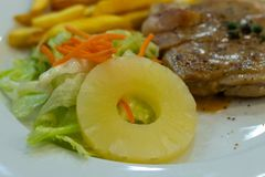 Chicken steak with French fries and salad. royalty free stock images