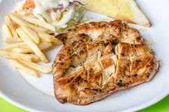 Chicken Steak, french fries with vegetables salad Stock Images