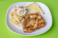 Chicken Steak, french fries with vegetables salad Royalty Free Stock Photos