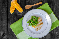 Chicken steak with garlic and lemon, salad Royalty Free Stock Photography